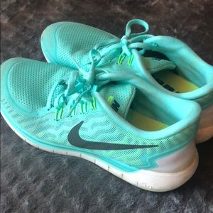 Teal Nike Free 5.0 running shoes